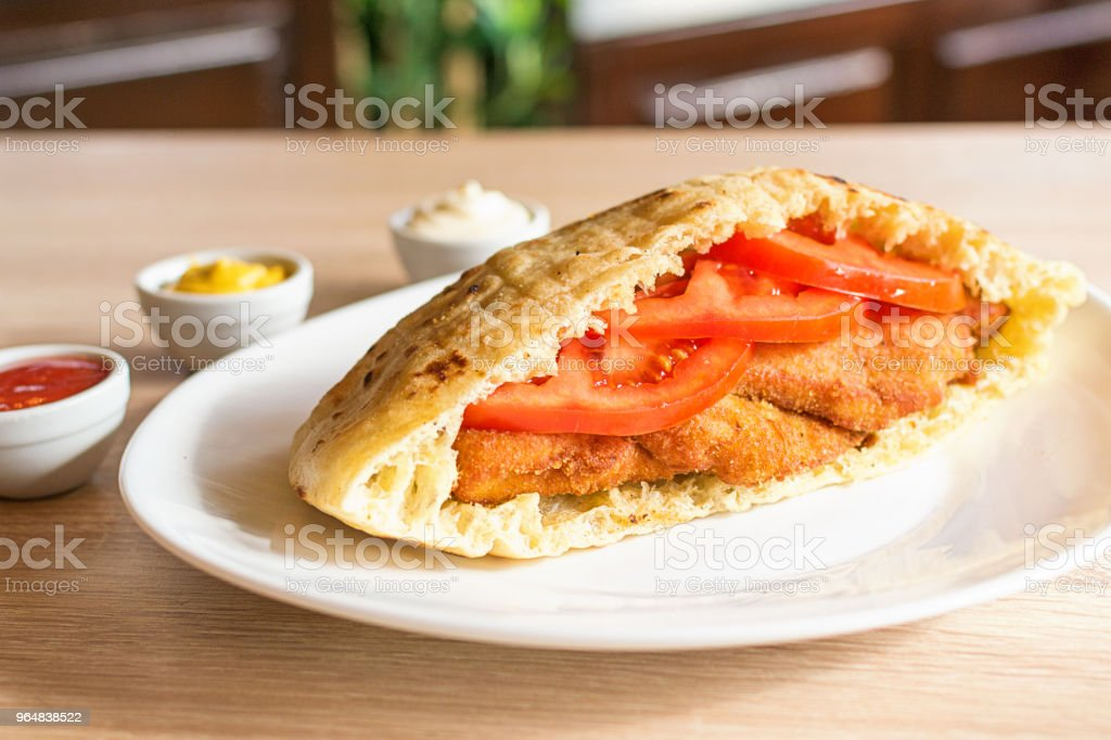 Delicious crispy chicken in pita bread with fresh salad ingredients royalty-free stock photo