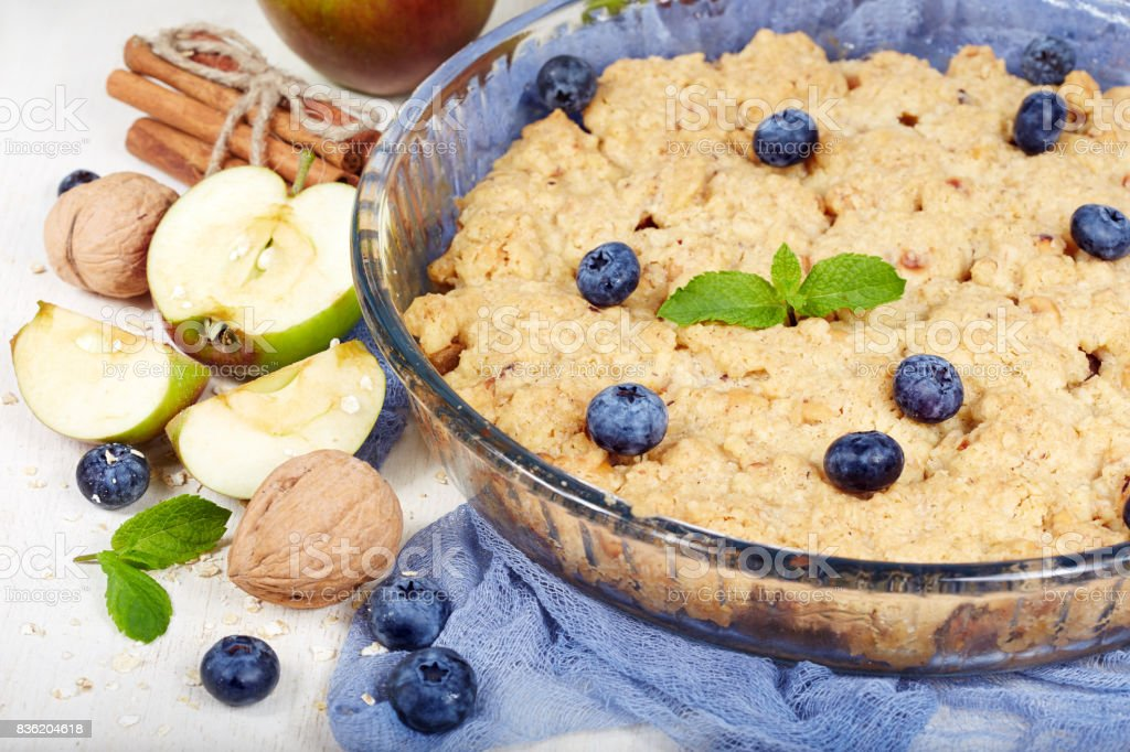 Delicious crumble pie with apples and cinnamon stock photo