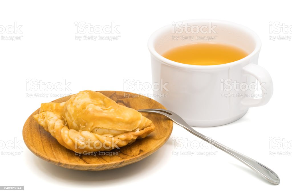Delicious Curry Puff in a wooden plate and a cup of tea stock photo