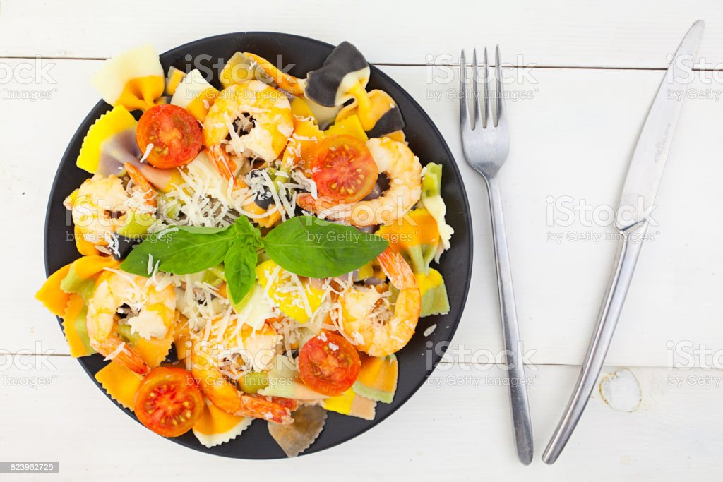 delicious delicious spaghetti with shrimps and basil on  plate stock photo
