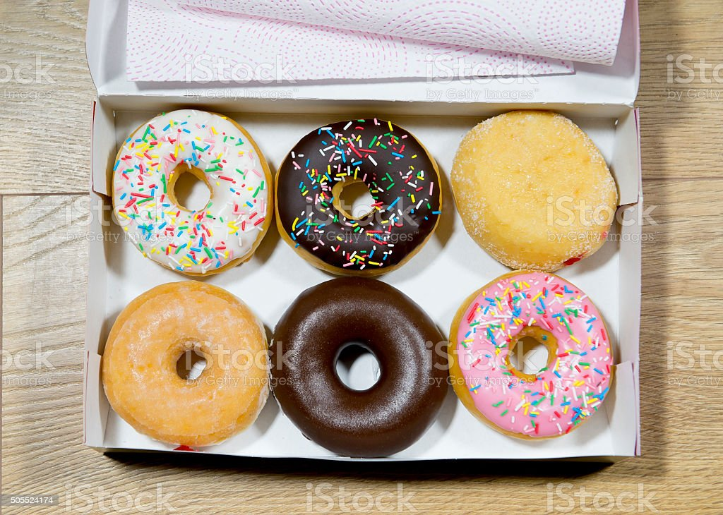 delicious donut box set in chocolate strawberry cream flavors stock photo