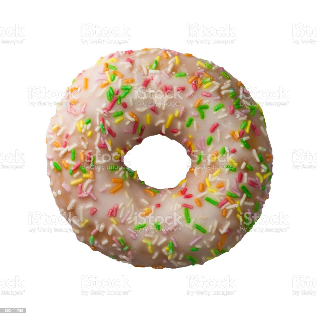 Delicious donut with colorful sprinkles isolated on white background - Zbiór zdjęć royalty-free (Bez ludzi)