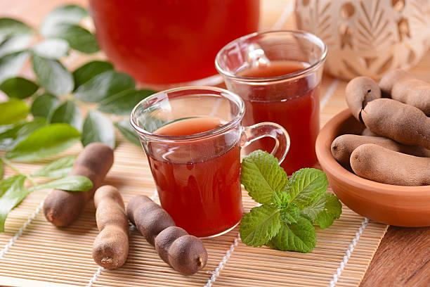 délicieuse boisson au tamarin - tamarin photos et images de collection