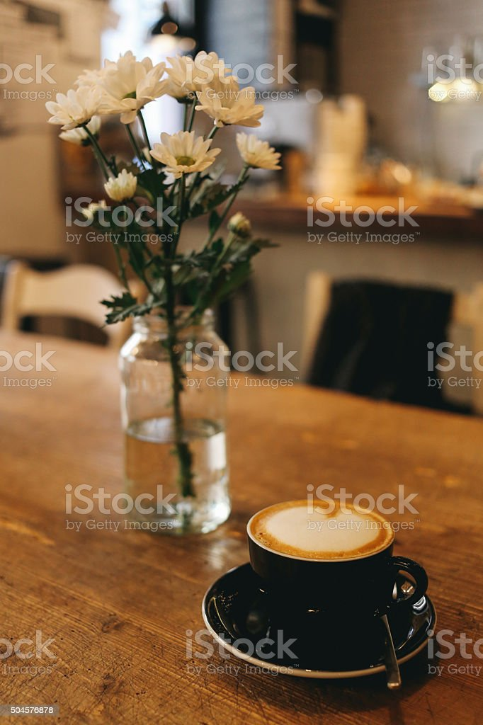 Delicious espresso on the wooden table in a Budapest cafe stock photo