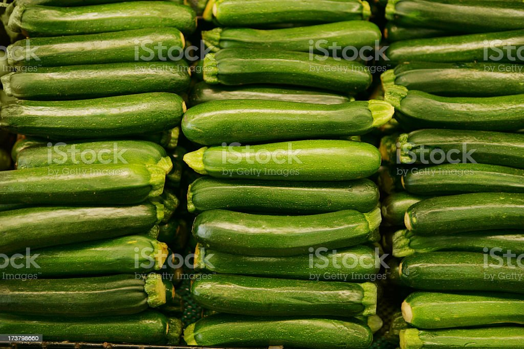 Delicious farmers market Zucchini in rows royalty-free stock photo