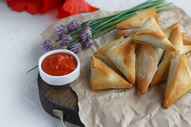 Delicious filo pastry pies with potato and tuna stock photo