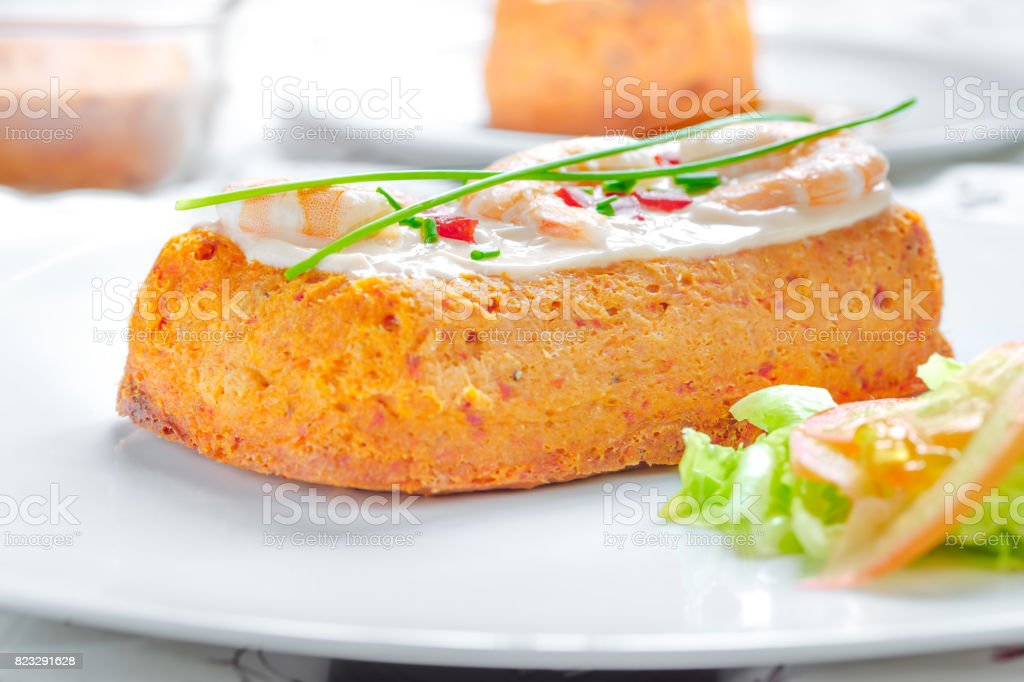 Delicious Fish cake. Hake cake with tomato, shrimps, chive and salad cream. stock photo
