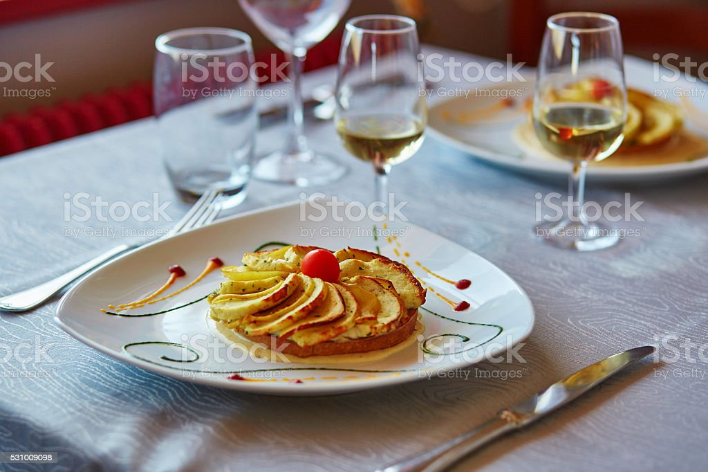 Delicious fish tartlet with vegetables stock photo
