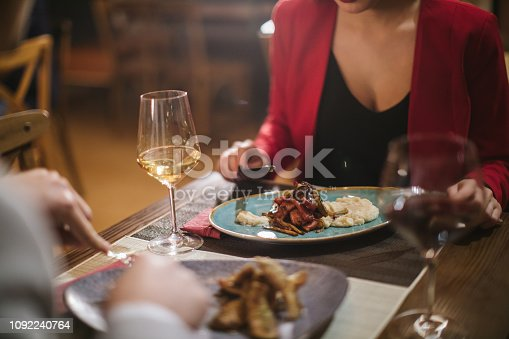 High angle view of dinner for two, unrecognizable couple eating
