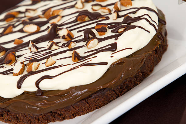 Delicious french cream, chocolate brownie and dulce de leche dessert stock photo