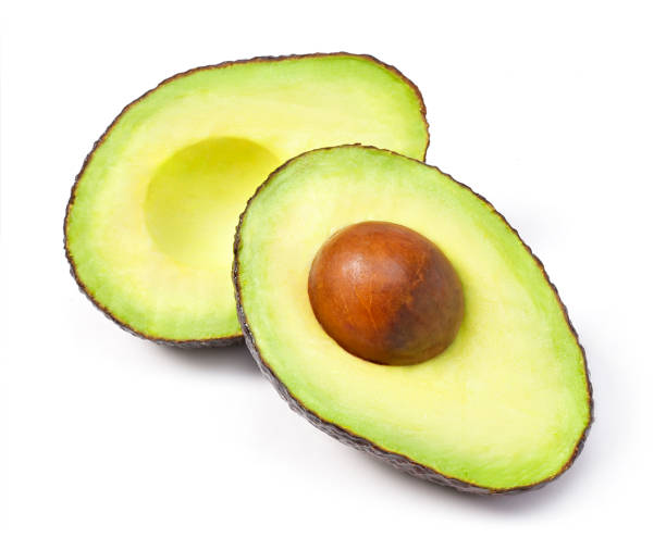 Delicious fresh avocado fruit, isolated on white background - fotografia de stock