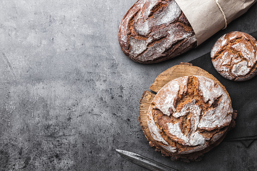 istock Delicious fresh bread on rustic background 819096148