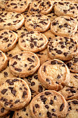 Fresh Chocolate chip cookies, freshly baked on rustic background. Close-up view with selective focus.