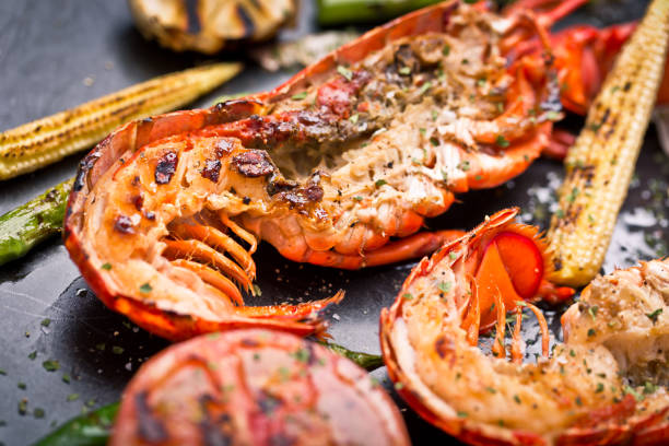 delicious fresh cooked and grilled lobster - tail stock photos and pictures
