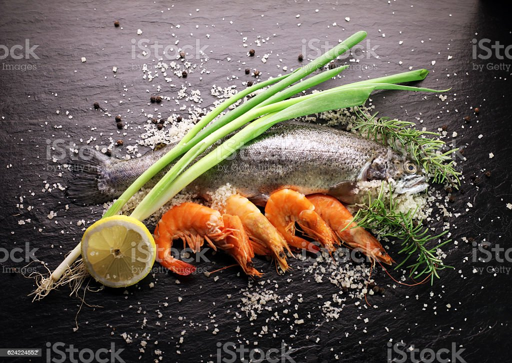 Delicious fresh fish on dark vintage background stock photo