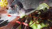 Delicious fresh fish on ice - gilthead, lobster, oyster