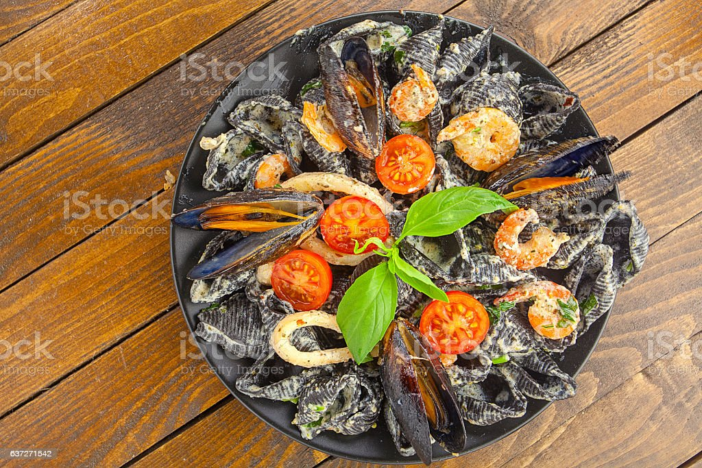 delicious fresh  pasta Neri on plate with shrimp stock photo