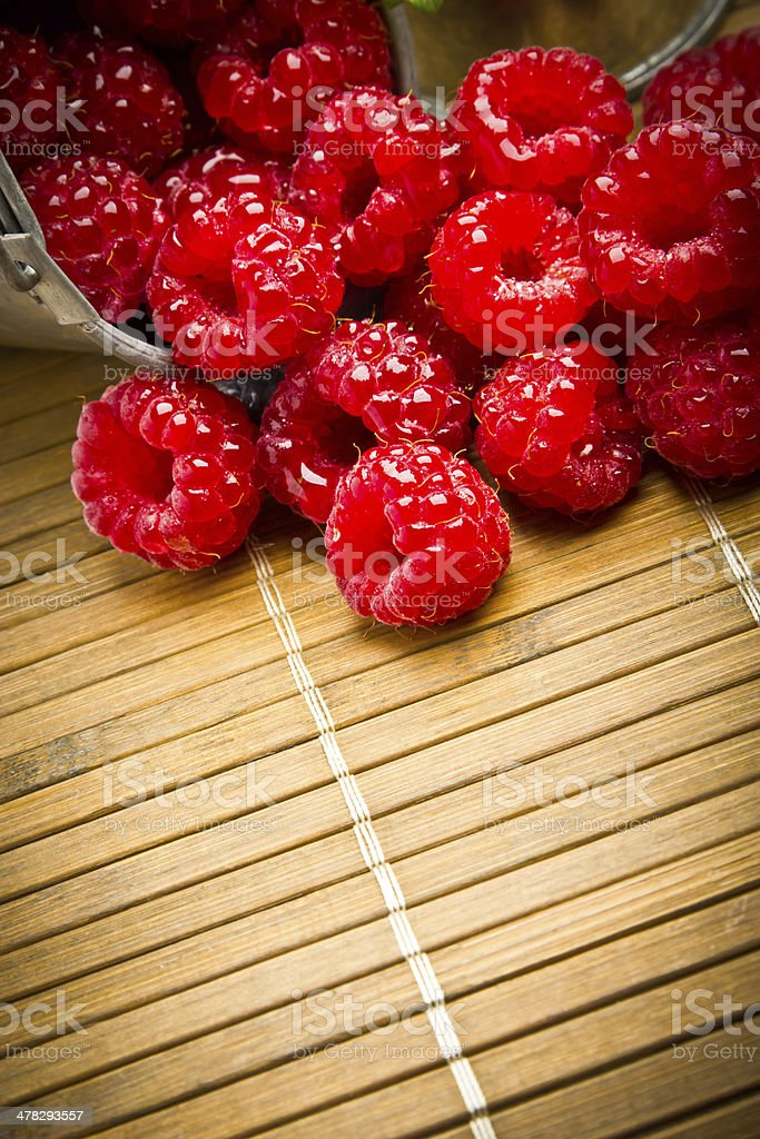 Delicious fresh raspberries on a wooden background royalty-free stock photo