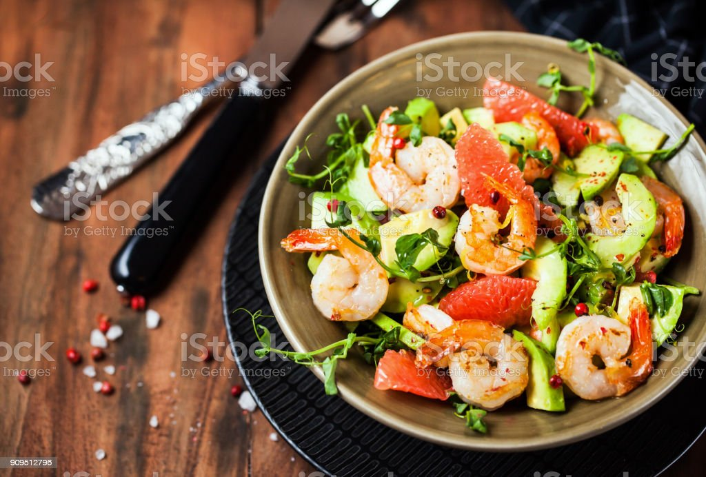 Delicious fresh salad with prawns, grapefruit, avocado, cucumber stock photo