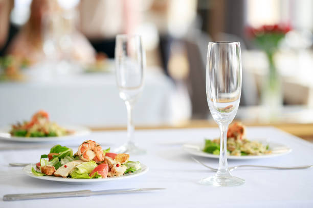 Delicious fresh salad with shrimps on restaurant table. stock photo