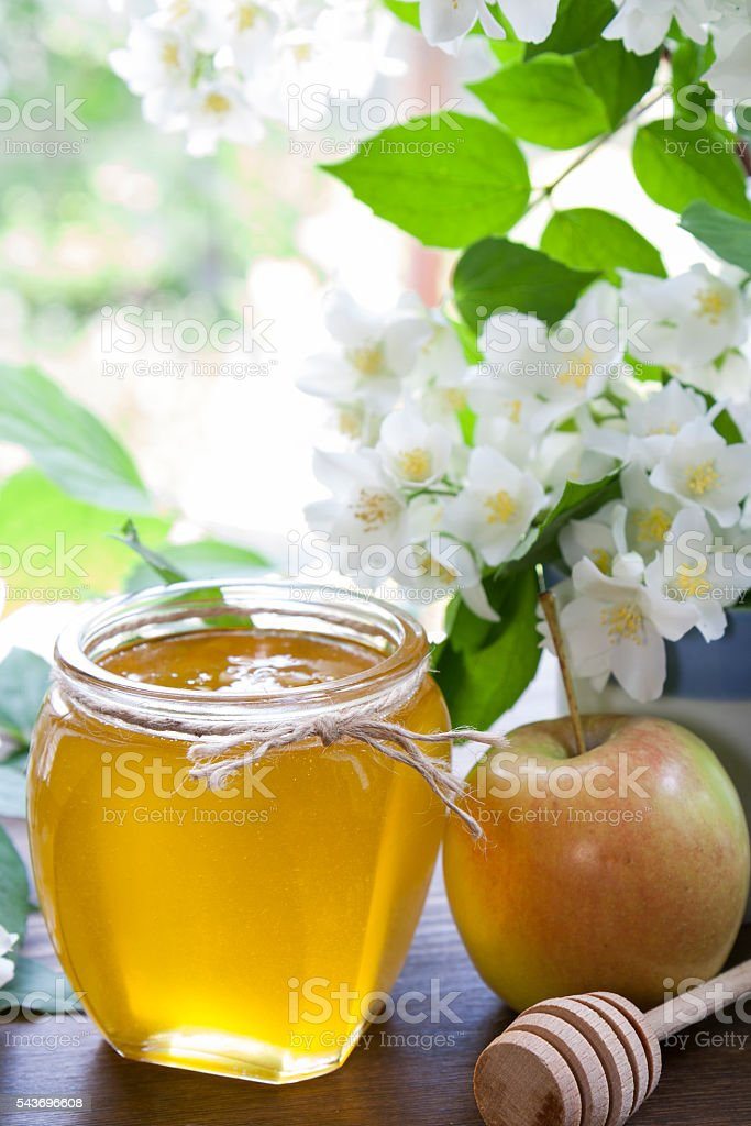 Delicious fresh spring honey in glass jar royalty-free stock photo