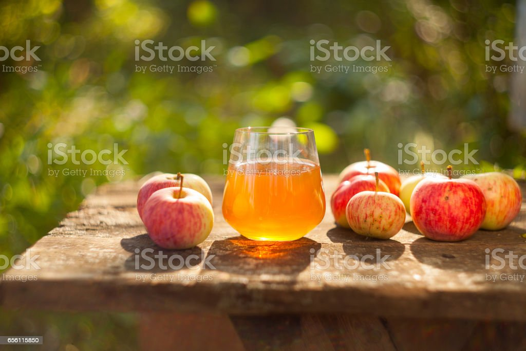 Delicious fresh squeezed apple juice in  transparent glass stock photo