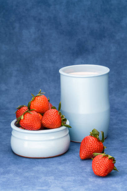Delicious fresh strawberries in a bowl with yogurt stock photo