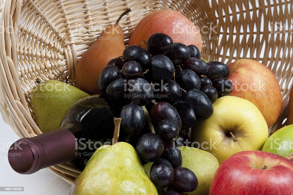 Delicious Fruit in Basket with Wine Bottle royalty-free stock photo