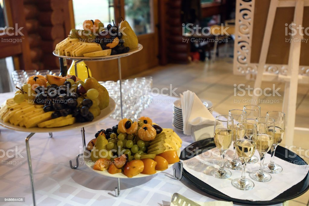 Delicious Fruit Table With Champagne Glasses And Different Sweets