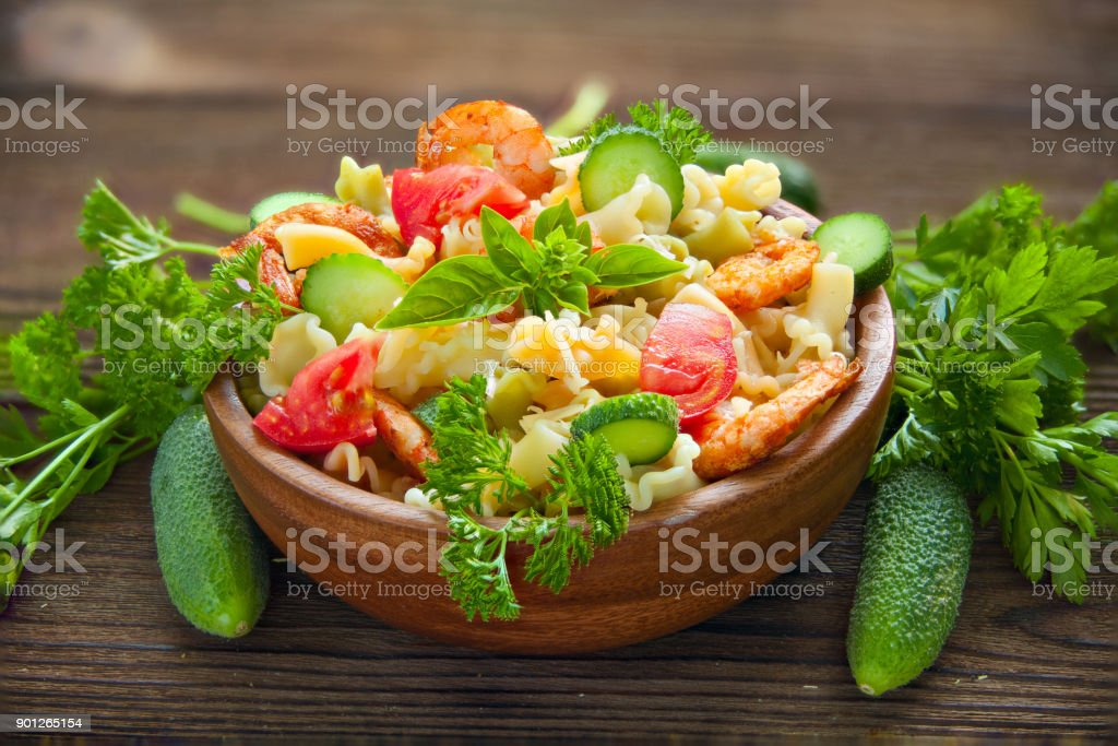 delicious gigli t with shrimps and basil on  plate stock photo