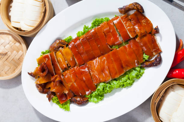 Delicious Golden Roasted BBQ Suckling pig on table. stock photo