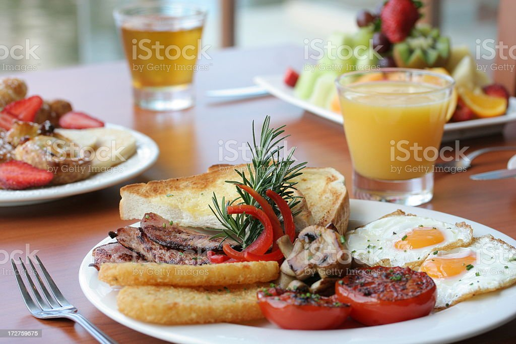 A delicious gourmet breakfast with orange juice royalty-free stock photo