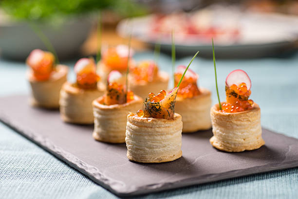 delicious graved salmon appetizers - food styling stock photos and pictures