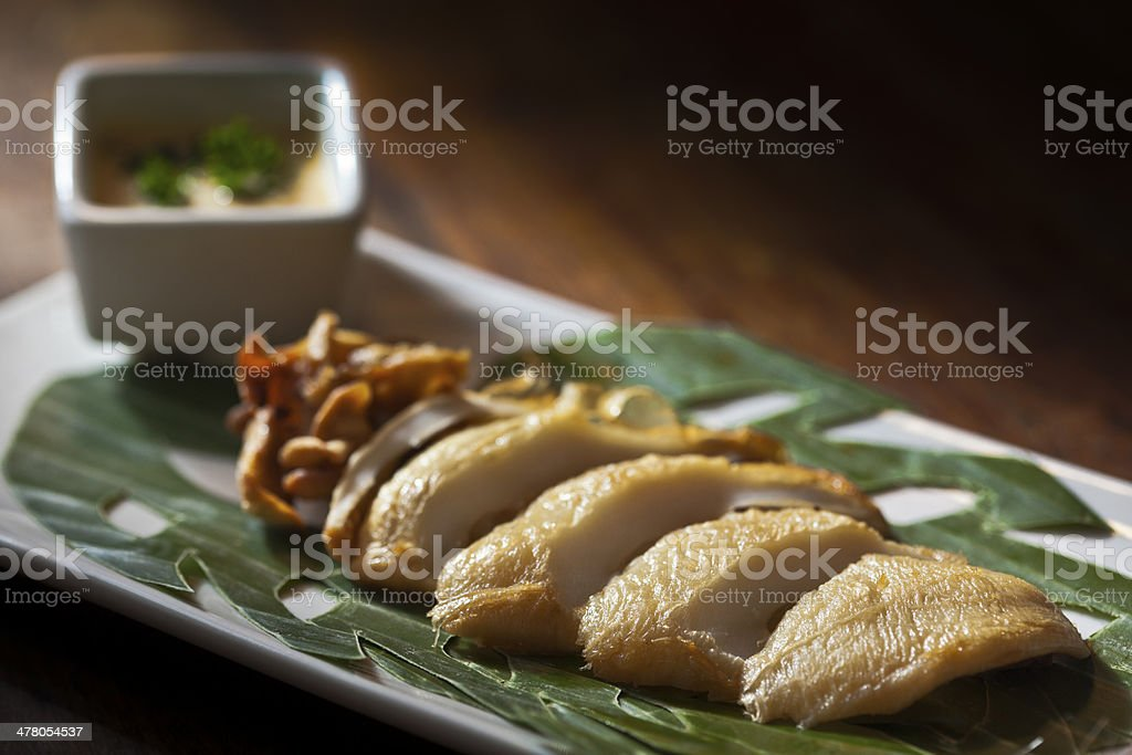 Delicious grilled calamari with spicy sauce royalty-free stock photo