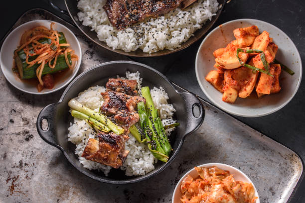 Delicious Grilled Kalbi on over Steamed Rice in Cast Iron Pan stock photo