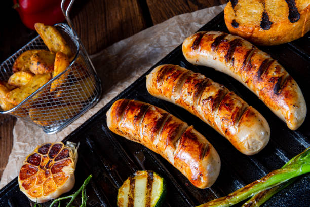 Delicious  grilled sausage with various grilled vegetables – zdjęcie