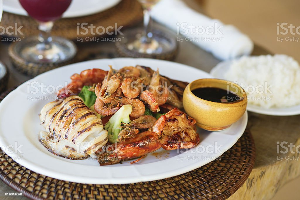 Delicious grilled squid with seafood stock photo