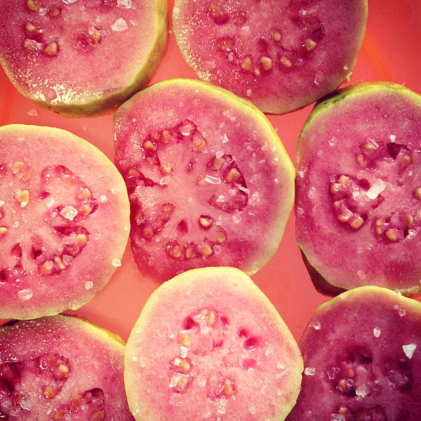 Delicious guava slices sprinkled with sea salt Delicious guava slices sprinkled with sea salt guava stock pictures, royalty-free photos & images