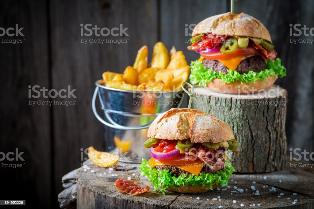 Delicious hamburger made of beef, vegetables and cheese stock photo