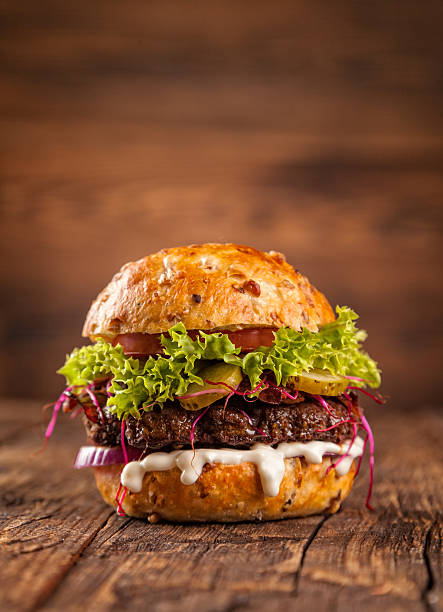 delicious hamburger on wood - juicy stock photos and pictures