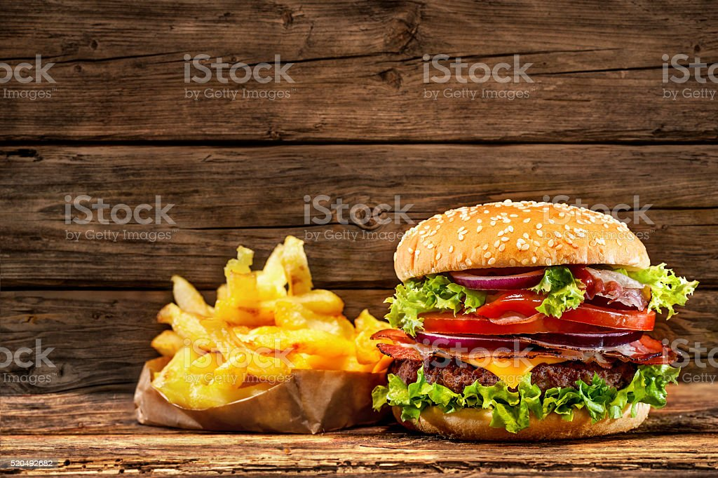 Delicious hamburger on wooden table stock photo