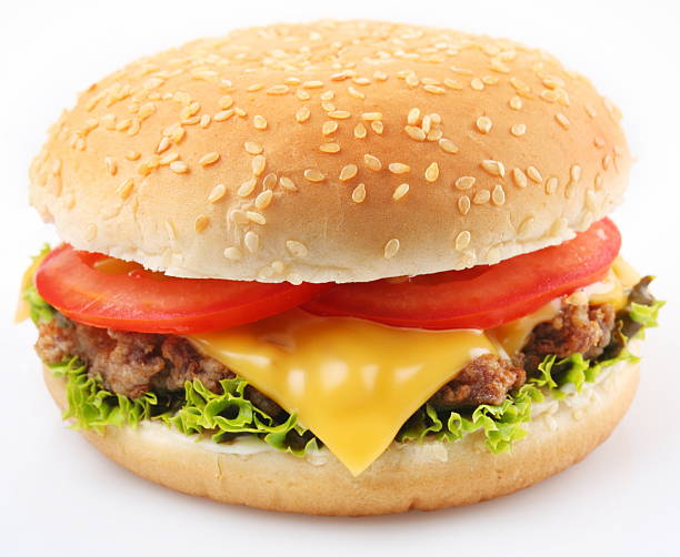 A delicious hamburger with tomato, cheese, and lettuce stock photo