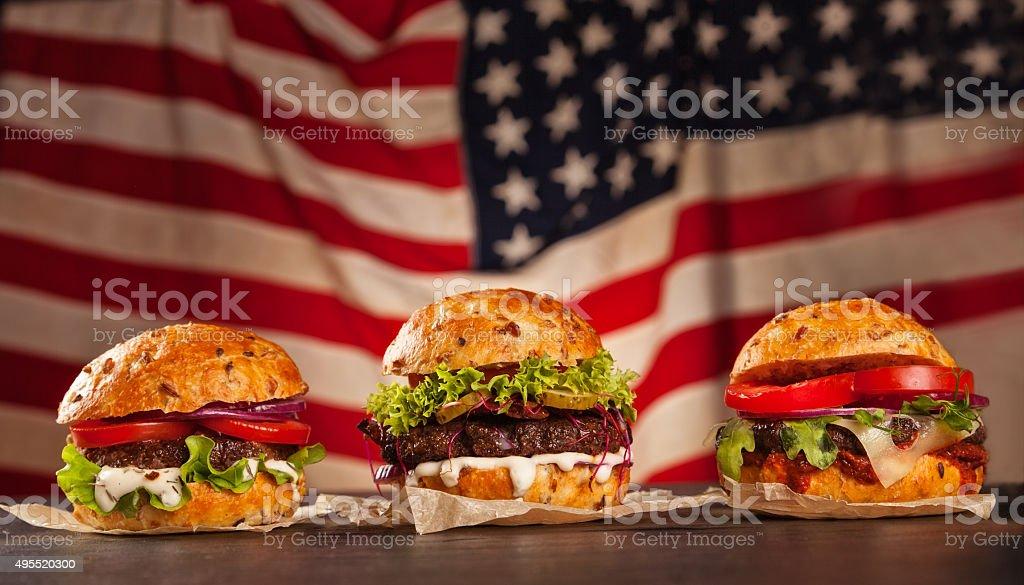 Delicious hamburgesr on wood stock photo