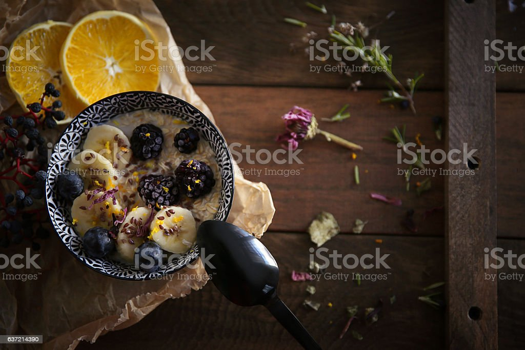Delicious healthy breakfast with raspberries, black grape, and a banana stock photo