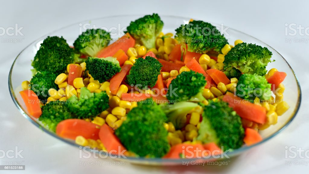 Delicious Home Made Healthy Sallad with Boiled Broccoli, Carrot and Sweet Corn stock photo
