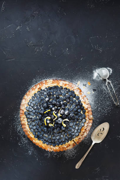 delicious homemade blueberry and mascarpone tart dusted with icing sugar - blueberry pie stock pictures, royalty-free photos & images