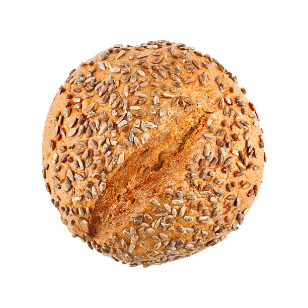 Delicious Homemade Bread A loaf of delicious homemade bread with sunflower seeds isolated on white background round loaf stock pictures, royalty-free photos & images