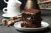 istock Delicious homemade brownie with chocolate sauce and caramel on the table. Selective focus 689260420