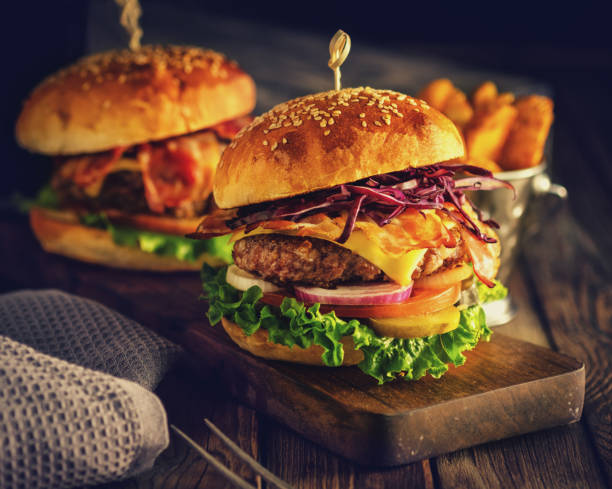 Delicious homemade hamburger on wooden background stock photo