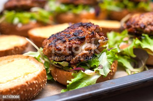 1156991909 istock photo Delicious homemade hamburger with lettuce and cheese in baking tray. Homemade dinner 647409066